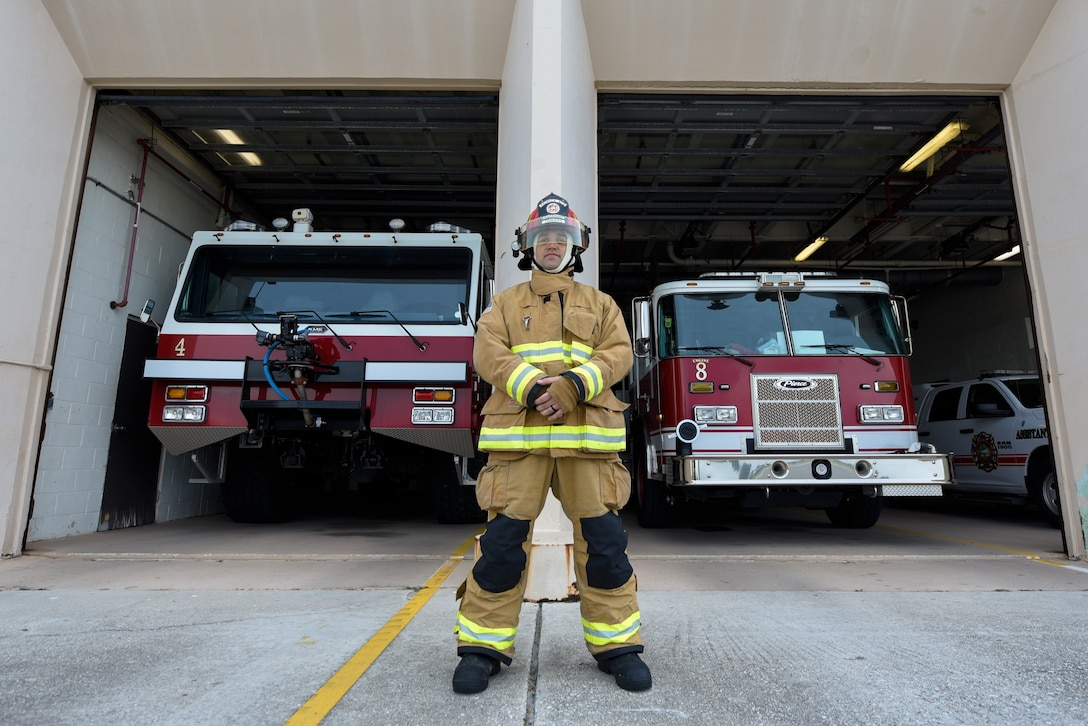"""SSgt Scott Travers, 45th Civil Engineering Squadron fire inspector, poses for an environmental portrait at the Patrick Air Force Base Fire Department, Florida, Oct. 20, 2020. Travers posed for the 45th Space Wing's """"People Of Patrick"""" series, which gives insight on Cape Canaveral Space Force Station and PSFB Airmen and their career. (U.S. Space Force Photo By Airman Thomas Sjoberg)"""