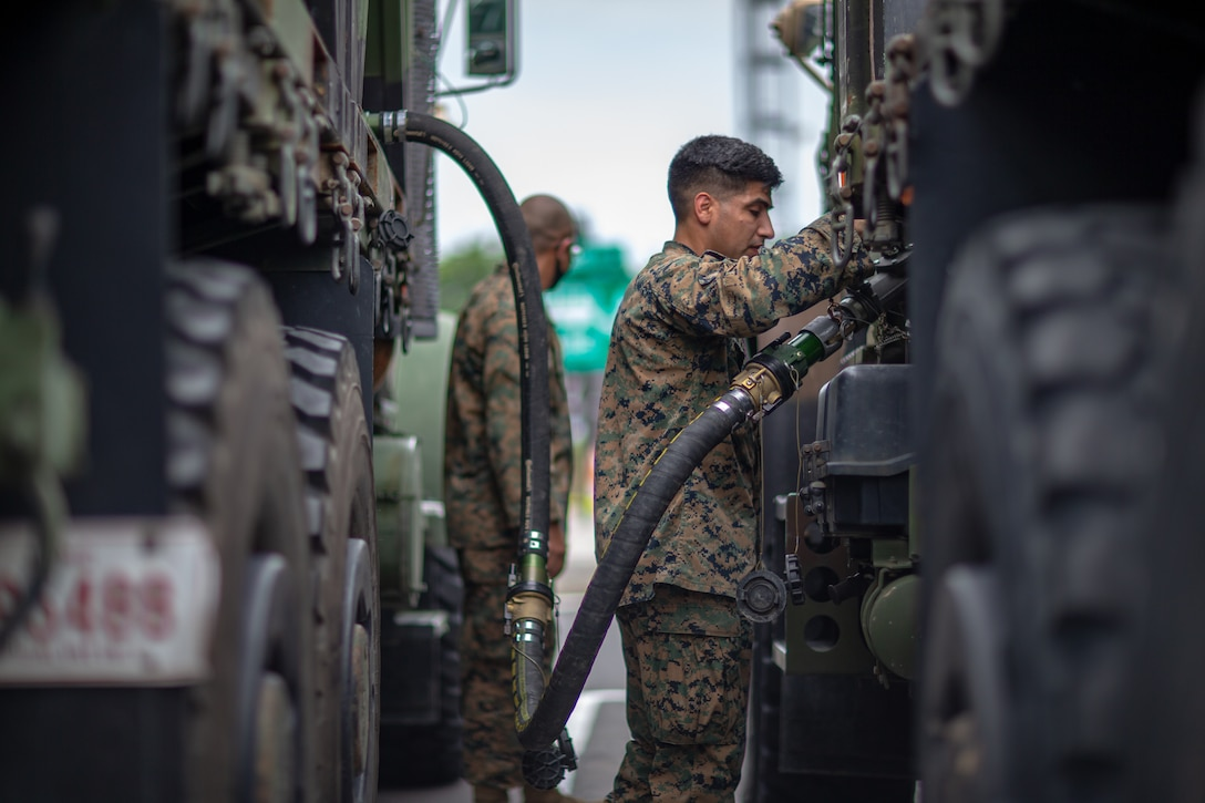 U.S. Marine Corps Staff Sgt. Jesus Alvarado, a motor transport operator with Marine Wing Support Squadron 171, fuels a 7-ton truck during a convoy at a rest stop in Japan, July 10, 2021. U.S. Marines with MWSS-171 began Eagle Wrath 21, a two-week exercise at CATC Camp Fuji to maintain a high level of proficiency and combat readiness.