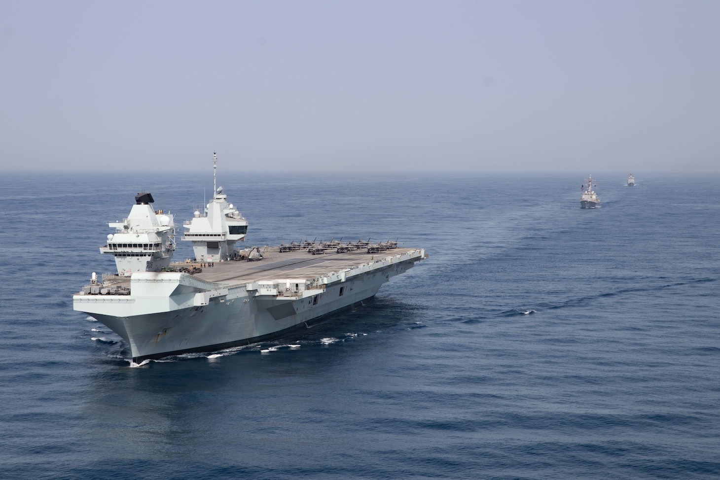 UK, Dutch and U.S. naval forces conduct an integrated at-sea exercise in the Gulf of Aden.