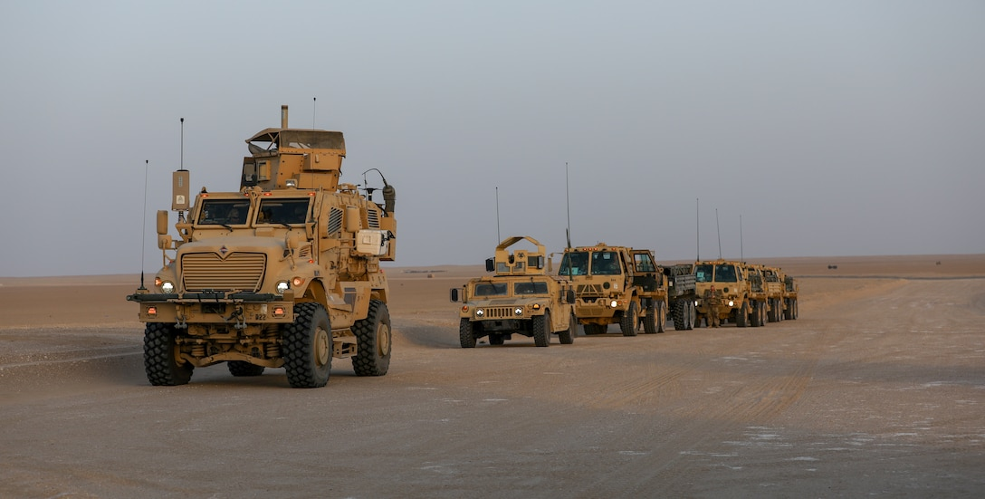 A MaxxPro Mine Resistant Ambush Protected (MRAP) vehicle belonging to Task Force Iron Valor waits in a column to move to a firing position at Udairi Range, Kuwait, June 2, 2021. TF Iron Valor conducted a night exercise to help Soldiers better prepare for live fire missions. (U.S. Army photo by Cpl. Kyle Burks)