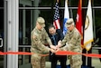 U.S. Army Aviation and Missile Command Commander Maj. Gen. Todd Royar (left), Director of the U.S. Army Test, Measurement, and Diagnostic Equipment Activity Dr. Richard Parker, and AMCOM Command Sergeant Maj. Mike Dove, cut a ribbon to reopen the newly renovated Maj. Gen. John M. Cone Metrology Laboratory during a ceremony June 29 at Redstone Arsenal, Ala.