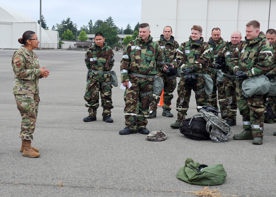 4th AF Command Chief speaks with Airmen in MOPP gear following an exercise.