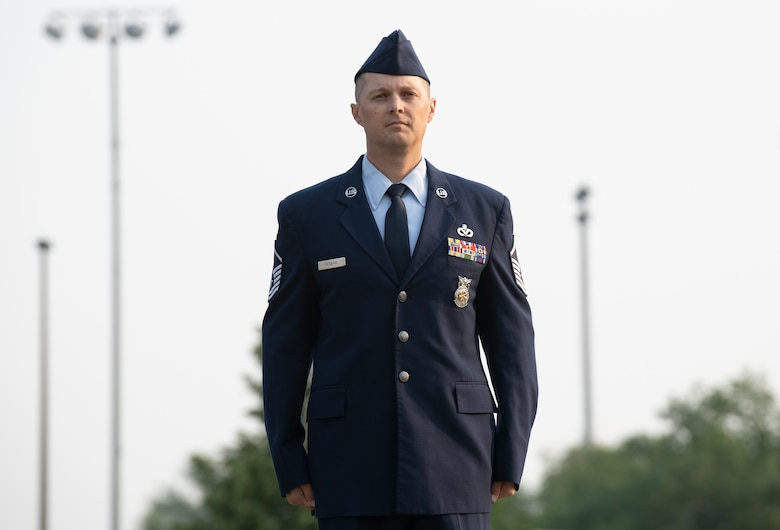 U.S. Air Force Master Sgt. Justin Rogers, 419th Civil Engineer Squadron, stands at attention before being presented the Airman's Medal at Hill Air Force Base, Utah on July 11, 2021. The Airman's Medal is a distinguished decoration awarded to those who display heroism or acts of heroism that involve a voluntary risk of life under non-combat conditions.