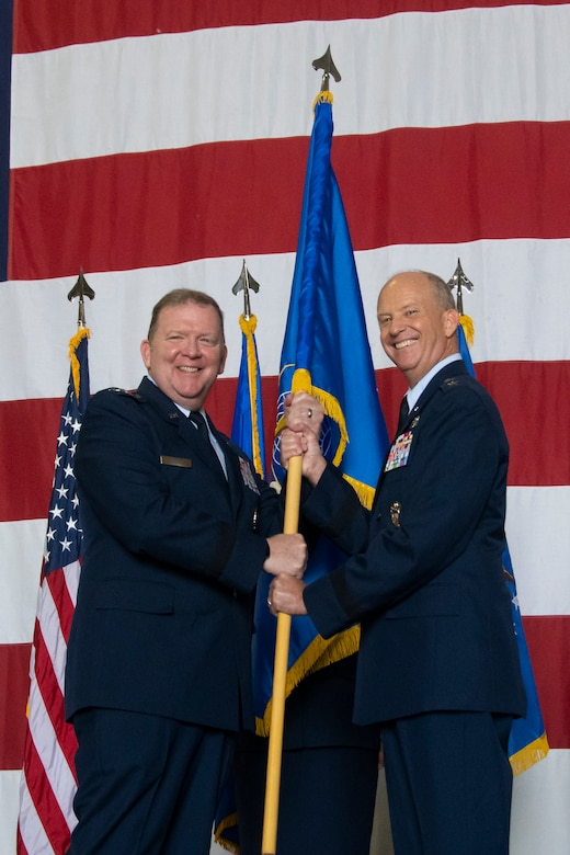 Maj. Gen. Bret C. Larson (right) took command of 22nd Air Force from Maj. Gen. John P. Healy during a ceremony at the Hangar 5, Dobbins Air Reserve Base, Georgia, July 10, 2021. The ceremony was officiated by Lt. Gen. Richard W. Scobee (left), commander of Air Force Reserve Command and Chief of the Air Force Reserve.  (U.S. Air Force photo by Senior Airman Kendra A. Ransum)