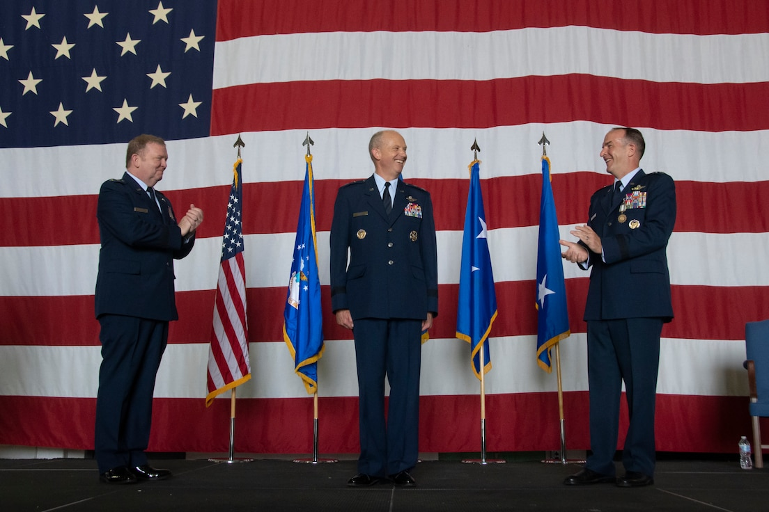 Maj. Gen. Brett C. Larson (center) is applauded by Lt. Gen. Ricahrd W. Scobee (left) and Maj. Gen. John P. Healy (right) following the 22nd Air Force change of command ceremony held at Dobbins Air Reserve Base, Georgia, July 10, 2021. (U.S. Air Force photo by Senior Airman Kendra A. Ransum)