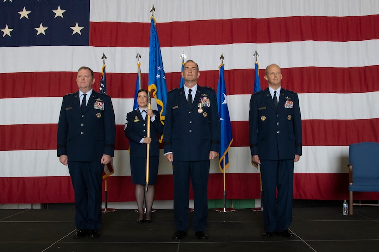 Maj. Gen. Bret C. Larson (right) takes command of 22nd Air Force from Maj. Gen. John P. Healy (center) during a ceremony at the Hangar 5, Dobbins Air Reserve Base, Georgia, July 10, 2021. The ceremony was officiated by Lt. Gen. Richard W. Scobee (left), commander of Air Force Reserve Command and Chief of the Air Force Reserve.  (U.S. Air Force photo by Senior Airman Kendra A. Ransum)