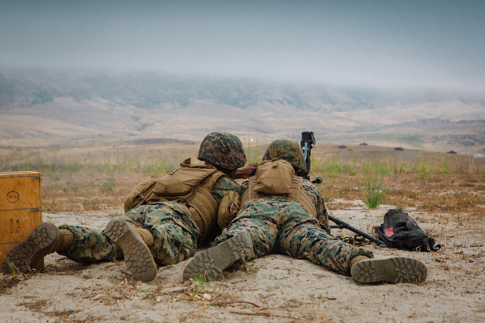 The Marines and Sailors participated in a live fire machine gun range to familiarize themselves with the weapon system as part of the Combat Skills Training School course.