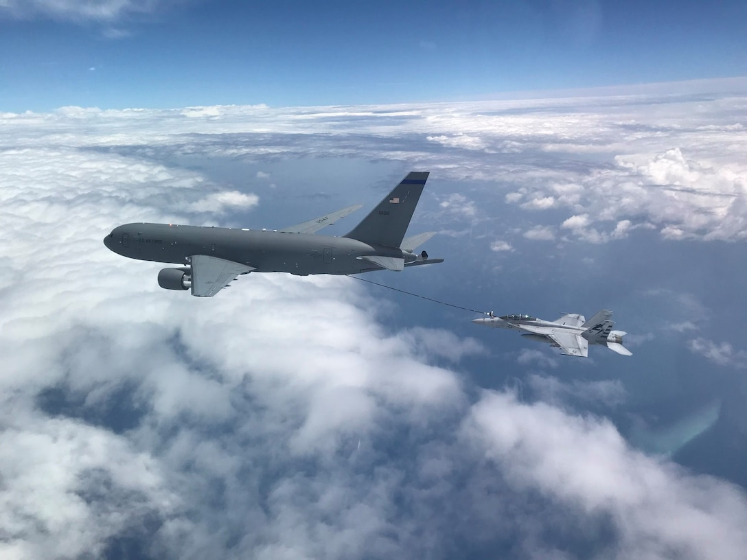 NH based KC-46A aircrew refuel a U.S. Navy F/A-18F Super Hornet off the coast of Maryland, July 1, 2020. This marked the first time the aircrew utilized the KC-46A centerline drogue system to refuel an aircraft. (Photo by Lt. Zach Fisher, U.S. Navy)