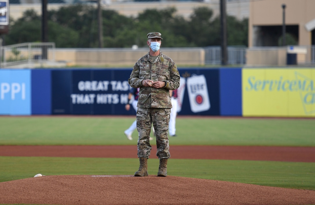 U.S. Air Force Col. William Hunter, 81st Training Wing commander, prepares to throw the first pitch during the Biloxi Shuckers Minor League Baseball game at Biloxi, Mississippi, July 10, 2021. Hunter also recited the oath of office to 10 Air Force delayed entry program recruits during pre-game festivities. (U.S. Air Force photo by Kemberly Groue)