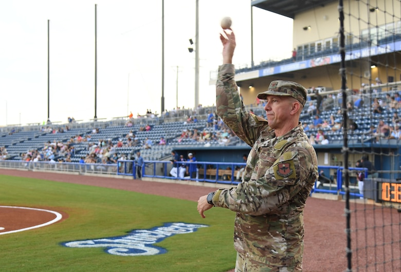 U.S. Air Force Col. William Hunter, 81st Training Wing commander, throws a practice pitch during the Biloxi Shuckers Minor League Baseball game in Biloxi, Mississippi, July 10, 2021. Hunter also recited the oath of office to 10 Air Force delayed entry program recruits during pre-game festivities. (U.S. Air Force photo by Kemberly Groue)
