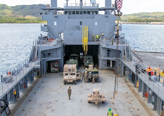 Military vehicles and containers are unloaded from the United States Army Vessel Lt. Gen. William B. Bunker, in support of Forager 21, at Naval Base Guam, July 10, 2021. Through innovation and experimentation during Forager, the theater Army is finding new ways to employ Army watercraft systems to increase logistical options to the commander and present new dilemmas to adversaries. (U.S. Army photo by Spc. Richard Carlisi, I Corps Public Affairs)