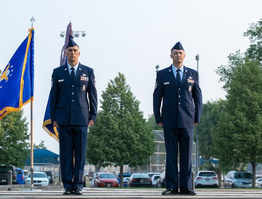 U.S. Air Force Senior Master Sgt. Chad Carrier (left) and Master Sgt. Justin Rogers, 419th Civil Engineer Squadron, stand at attention during a ceremony where they were awarded the Airman's Medal at Hill Air Force Base, Utah on July 11, 2021. Carrier and Rogers displayed exemplary heroism actions when they saved the life of a trapped driver by pulling him from a burning vehicle.