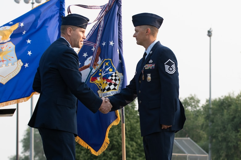 U.S. Air Force Master Sgt. Justin Rogers, 419th Civil Engineer Squadron, receives the Airman's Medal from Col. Matthew Fritz, 419th Fighter Wing commander, during a ceremony at Hill Air Force Base, Utah on July 11, 2021. Rogers displayed exemplary heroism actions when he saved the life of a trapped driver by pulling him from a burning vehicle.