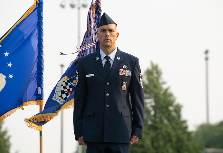 U.S. Air Force Senior Master Sgt. Chad Carrier, 419th Civil Engineer Squadron, stands at attention before being presented the Airman's Medal at Hill Air Force Base, Utah on July 11, 2021. The Airman's Medal is a distinguished decoration awarded to those who display heroism or acts of heroism that involve a voluntary risk of life under non-combat conditions.