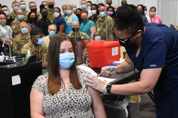 Emma L. Jenks, 21, of Millerton, New York, gets one of the last vaccinations at the Jacob K Javits mass vaccination site in Manhattan July 9, 2021. Jenks, the daughter of New York Army National Guard Sgt. Major Robert, received her second Pfizer vaccination from nurse Christina Davis-Riley and New York Air National Guard Tech. Sgt. Mark Manual, a member of the 105th Airlift Wing, who served as the data entry technician. Representatives from the agencies that comprised Joint Task Javits witnessed the occasion.