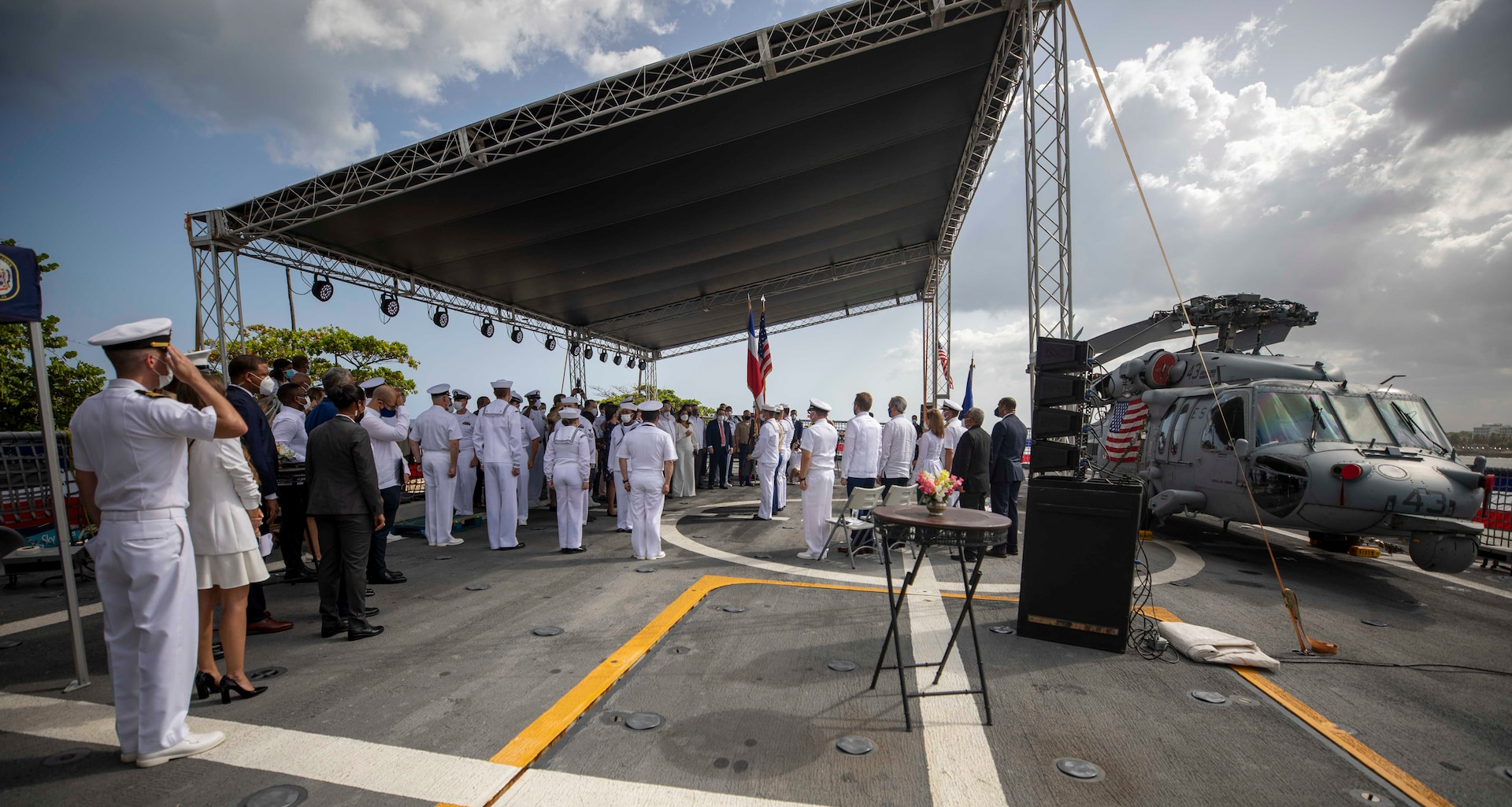 Honored guests stand for the U.S. national anthem during a reception on the flight deck aboard the Freedom-variant littoral combat ship USS Billings (LCS 15), July 9, 2021.
