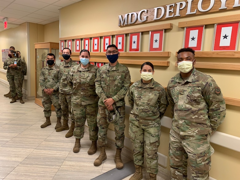 Group of medical personnel stand together.