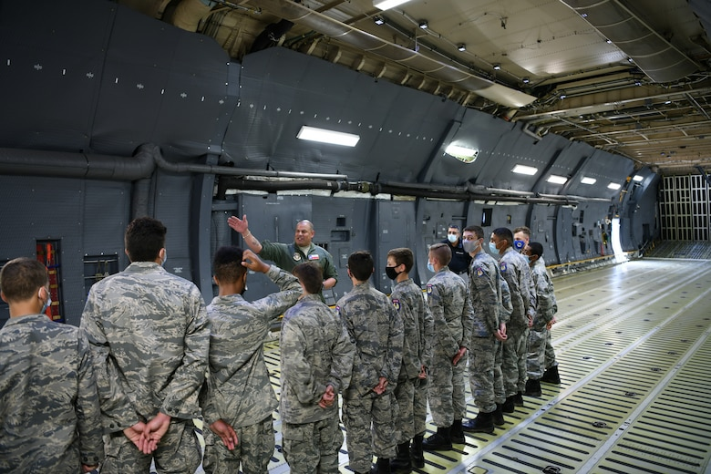 Master Sgt. Eric Mungia, 68th Airlift Squadron loadmaster, talks to Texas Wing Civil Air Patrol cadets about the C-5M Super Galaxy aircraft at Joint Base San Antonio-Lackland, Texas, July 8, 2021. This visit promoted awareness of U.S. Air Force Reserve career options for the Cadets. (U.S. Air Force photo by Master Sgt. Kristian Carter)