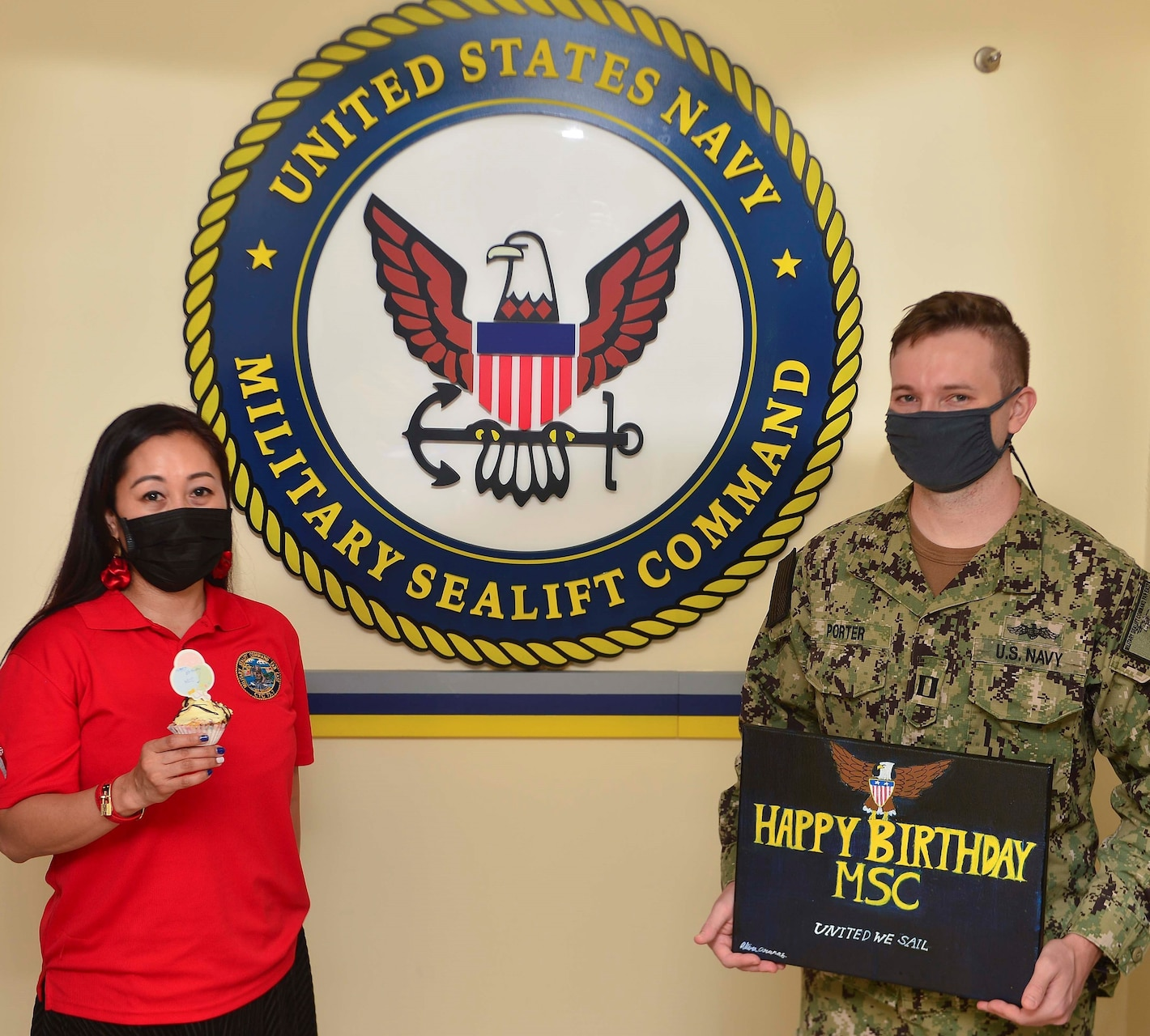 210709-N-UA460-002 SINGAPORE (July 9, 2021) From left, Military Sealift Command Far East's Theresa Aranas and Lt. Gerrit Porter, a reservist, recognize MSC's birthday on July 9.   MSC FE ensures approximately 50 ships in the Indo-Pacific region, are manned, trained and equipped to deliver essential supplies, fuel, cargo, and equipment to warfighters, both at sea and on shore. Task force commanders employ these ships to ensure mission accomplishment. COMLOG WESTPAC/CTF 73 is the U.S. 7th Fleet's provider of combat-ready logistics, operating government-owned and contracted ships that keep units throughout 7th Fleet armed, fueled and fed. As the U.S. Navy's largest forward-deployed fleet, 7th Fleet employs 50-70 ships and submarines across the Western Pacific and Indian oceans. U.S. 7th Fleet routinely operates and interacts with 35 maritime nations while conducting missions to preserve and protect a free and open Indo-Pacific Region. Military Sealift Command is the leading provider of ocean transportation for the Navy and the rest of the Department of Defense - operating approximately 125 ships daily around the globe. (U.S. Navy photo by Mass Communication Specialist 1st Class Gregory Johnson)