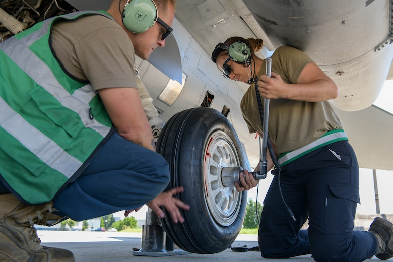 U.S. Air Force F-16 Fighting Falcon crew chiefs assigned to the 555th Aircraft Maintenance Unit replace an F-16 tire during exercise Thracian Star 21 at Graf Ignatievo Air Base, Bulgaria, July 9, 2021. More than 150 personnel and eight F-16s assigned to the 555th Fighter Squadron are participating in Thracian Star 21, a Bulgarian air force-led, multilateral training exercise, aimed to enhance the ability to rapidly deploy to remote locations and provide credible force to assure stability for the region. (U.S. Air Force photo by Airman 1st Class Brooke Moeder)