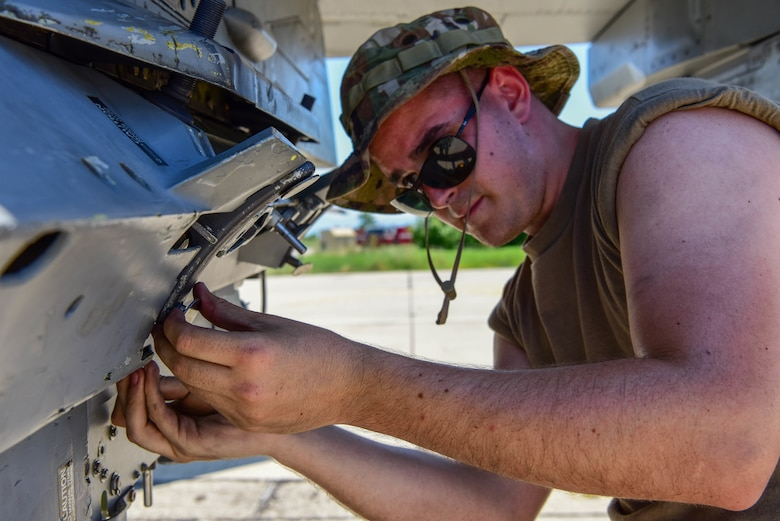 A  weapons load crew member assigned to the 555th Aircraft Maintenance Unit resets a triple ejector rack on a U.S. Air Force F-16 Fighting Falcon during Thracian Star 21 at Graf Ignatievo Air Base, Bulgaria, during exercise Thracian Star 21, July 9, 2021. Thracian Star 21 is a Bulgaria air force-led operational and tactical level live-fly field training exercise from July 9-23, 2021. (U.S. Air Force photo by Airman 1st Class Brooke Moeder)