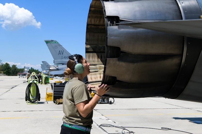 An F-16 Fighting Falcon crew chief assigned to the 555th Aircraft Maintenance Unit inspects a U.S. Air Force F-16 during exercise Thracian Star 21 at Graf Ignatievo Air Base, Bulgaria, July 9, 2021. Thracian Star 21 aims to enhance the ability to rapidly forward deploy, sustain operations, and work in coordination with partners and allies. (U.S. Air Force photo by Airman 1st Class Brooke Moeder)