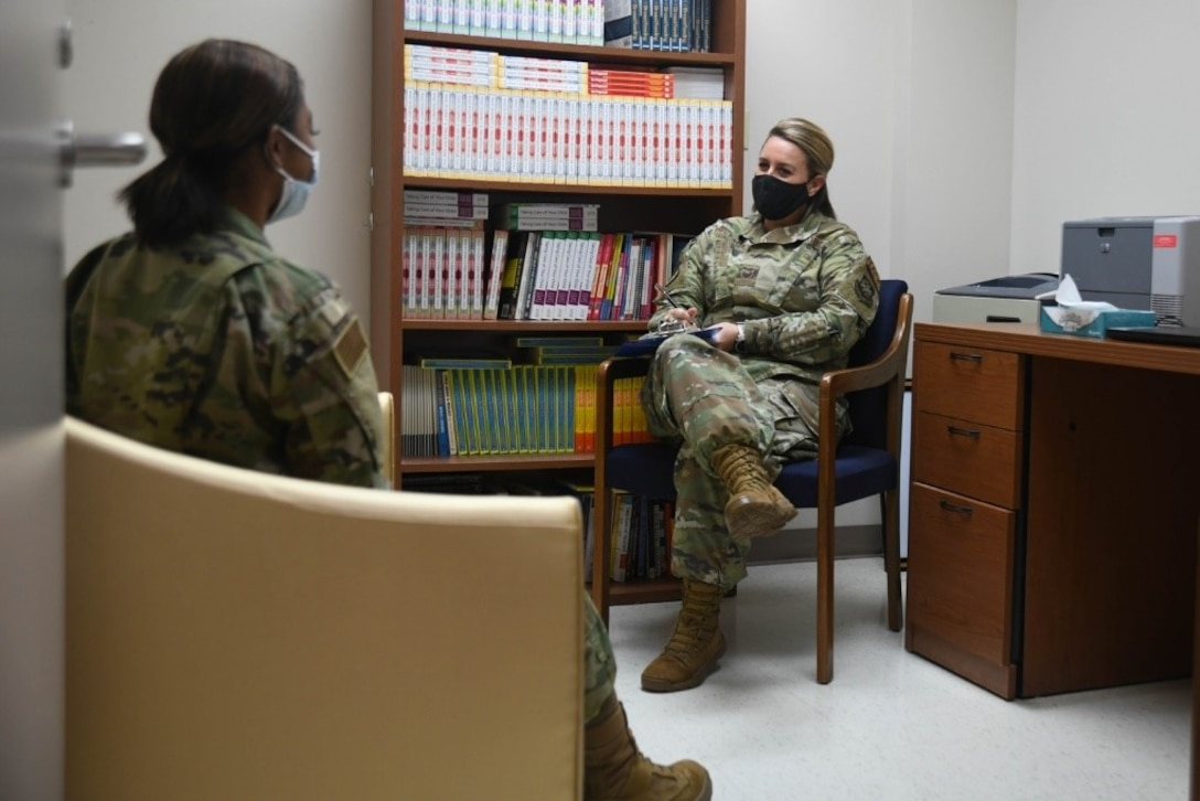 Staff Sgt. Alicia Delvaux, 22nd Medical Operations Squadron mental health technician, speaks to an Airman in her office during an appointment June 11, 2021, at McConnell Air Force Base, Kansas. Patients have the option of self-referral either via phone line or by stopping by the clinic during duty hours. (U.S. Air Force photo by Senior Airman Nilsa Garcia)