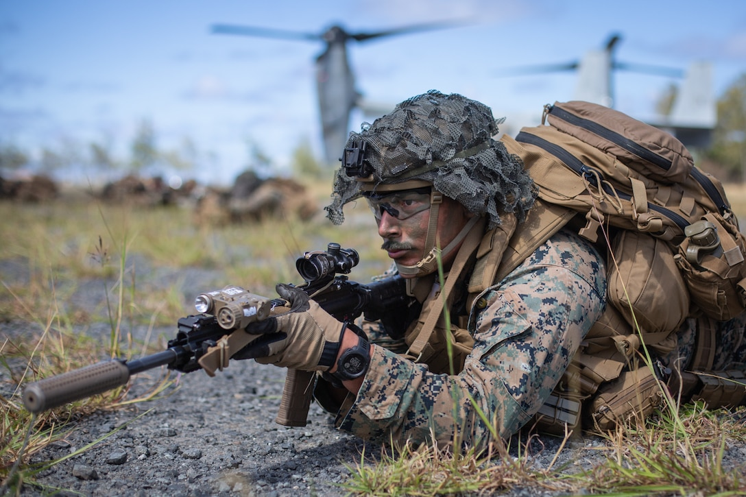 U.S. Marine Corps Cpl. Kevin Hernandez, a rifleman with 1st Battalion, 3rd Marines, 3rd Marine Division, provides security during an air assault at Marine Corps Training Area Bellows, July 9, 2021. The training strengthened the battalion's proficiency in urban operations, while demonstrating their ability to quickly seize and defend key maritime terrain. 1/3 is training to become the first Littoral Combat Team in accordance with Force Design 2030. Hernandez is a native of Azle, Texas.
