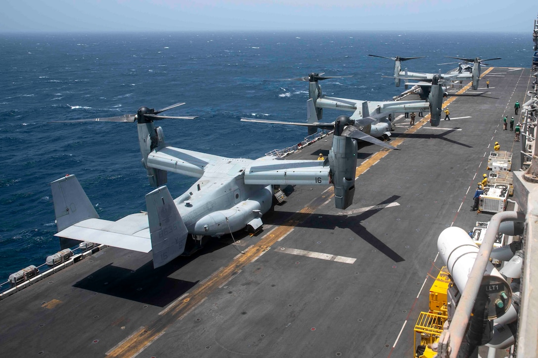 GULF OF ADEN (July 10, 2021) MV-22B Osprey tiltrotor aircraft, attached to Marine Medium Tiltrotor Squadron (VMM) 162 (Reinforced), undergo pre-flight checks on the flight deck of amphibious assault ship USS Iwo Jima (LHD 7) during flight operations in the Gulf of Aden, July 10. Iwo Jima is deployed to the U.S. 5th Fleet area of operations in support of naval operations to ensure maritime stability and security in the Central Region, connecting the Mediterranean and Pacific through the western Indian Ocean and three strategic choke points. (U.S. Navy photo by Mass Communication Specialist Seaman Isaac A. Rodriguez)