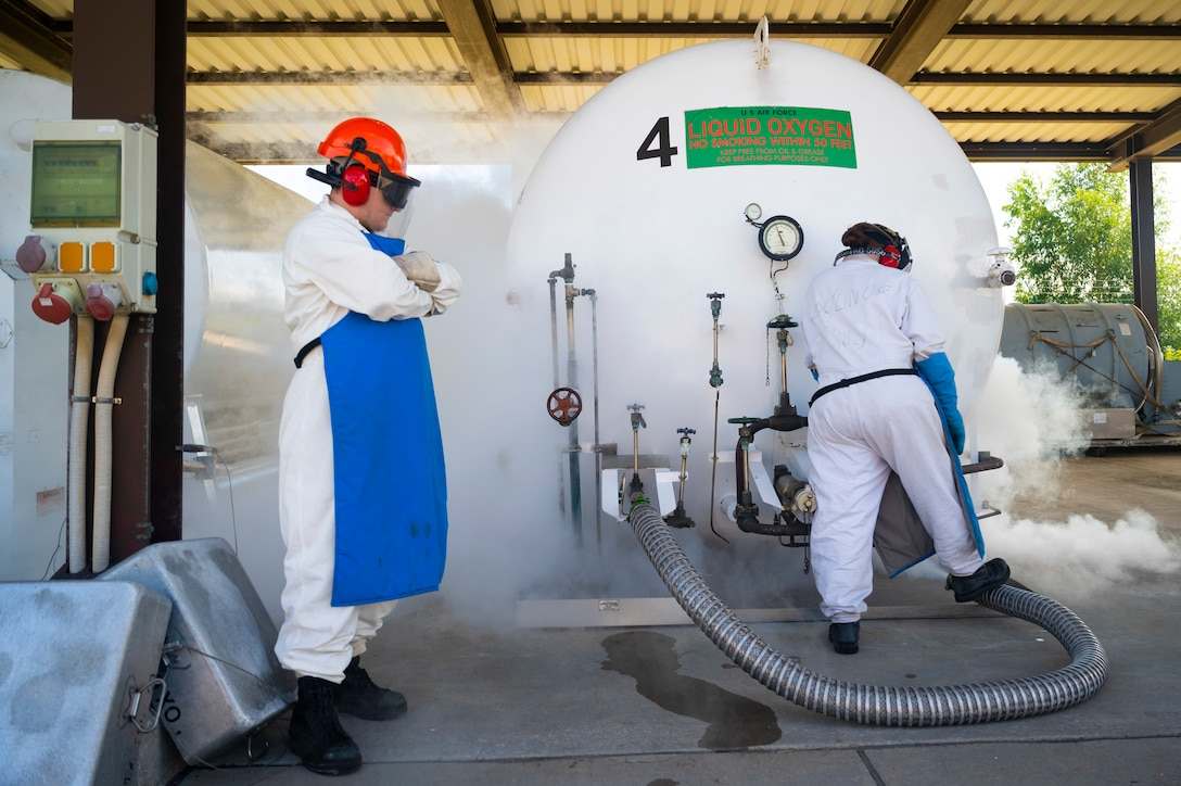 U.S. Air Force Senior Airman Aaron Irving, 86th Logistics Readiness Squadron fuels facilities operator, left, and Airman 1st Class Amber Butler 86th LRS fuels facilities operator check the levels of liquid oxygen