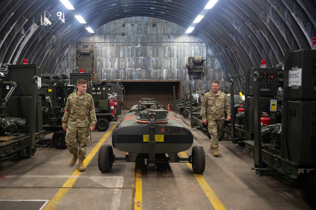 U.S. Air Force Staff Sgt. Bryant Griffith, 86th Logistics Readiness Squadron, left, and Tech. Sgt. Drew Killian, 86th LRS fuels environmental and safety office noncommissioned officer in charge, conducts an inspection of reserve fuel equipment