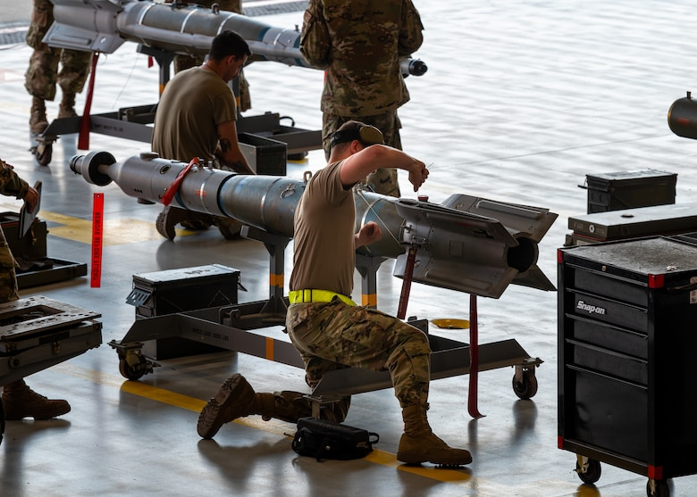 A photo of a weapons load competition