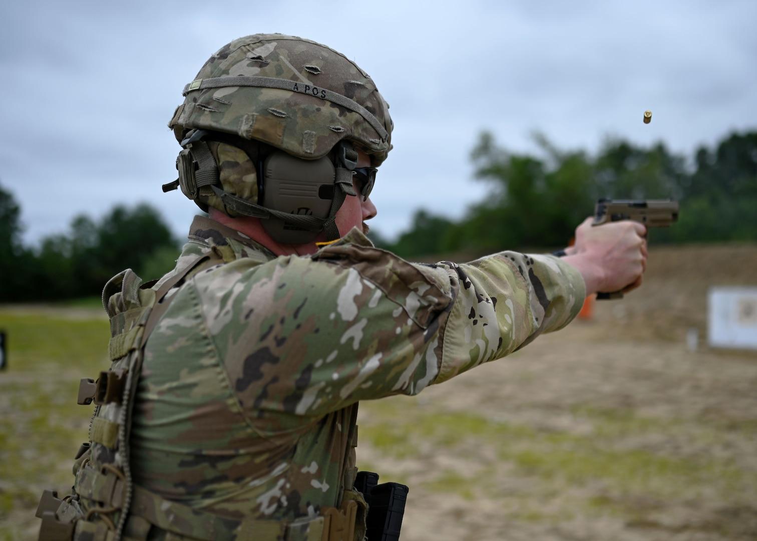 Staff Sgt. Dean Van Tassel of A Battery, 3-197th Field Artillery Brigade, fires an M17 pistol during the NHNG annual combat marksmanship competition July 8, 2021,a t Fort Devens, Mass.