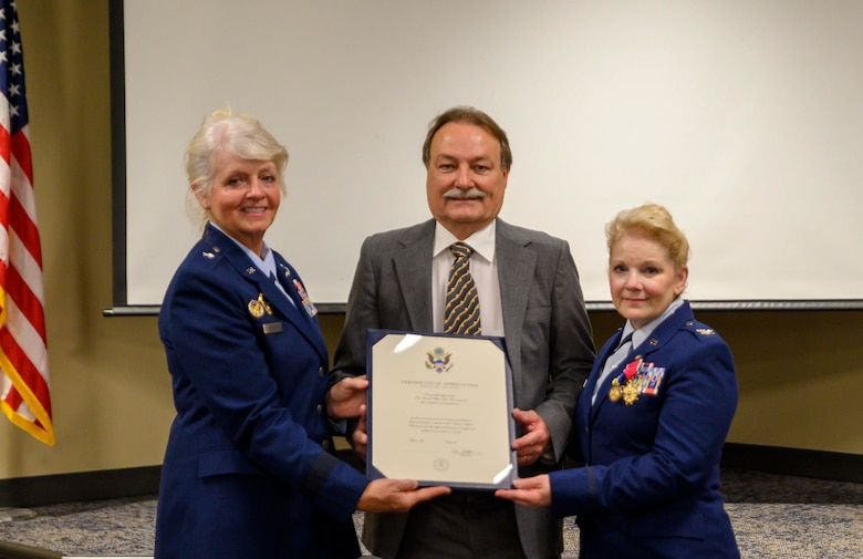 Col. Gardner displays her official retirement annoucment.