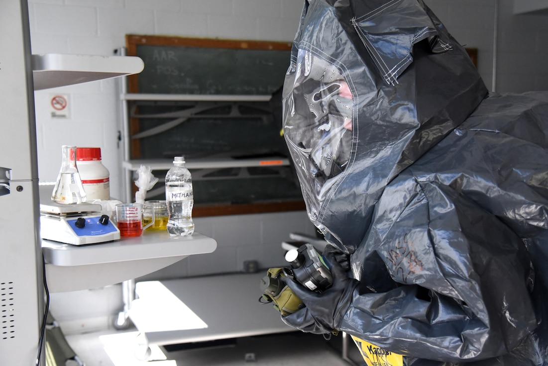 Virginia National Guard Soldiers and Airmen assigned to the Fort Pickett-based 34th Civil Support Team conduct a site assessment on a mock drug lab during a training exercise June 24, 2021, at the Manassas Readiness Center in Manassas, Virginia.