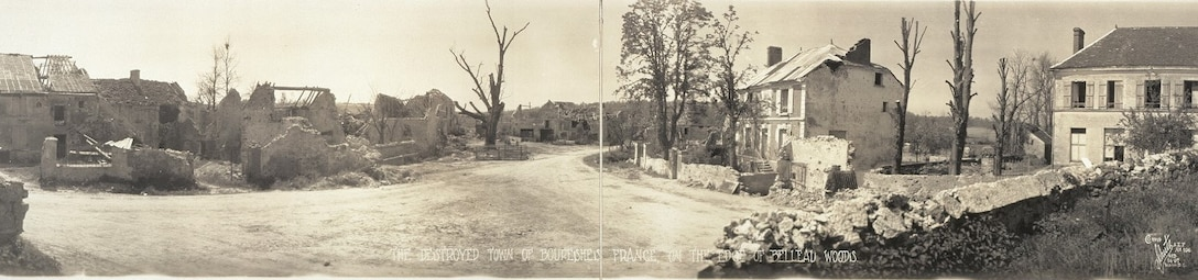 Rubble and two dilapidated houses are all that remains of a small town after World War I.
