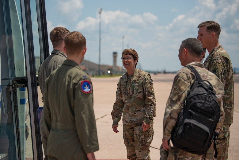 U.S. Air Force Gen. Jacqueline Van Ovost, Air Mobility Command commander, center, is greeted by Airman from the 317th Airlift Wing at Dyess Air Force Base, Texas, July 7, 2021. The AMC command team visited Dyess AFB where they met some of the Airmen accelerating the air mobility mission. (U.S. Air Force photo by Senior Airman Colin Hollowell)