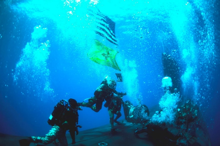 U.S. Navy SEALs conduct diving operations with the Virginia-class attack submarine USS New Mexico (SSN 779) during interoperability training in the Mediterranean Sea, June 28, 2021. This training demonstrated the ability for submarines to seamlessly integrate SEALs into Navy missions in the U.S. Sixth Fleet area of operations to ensure global access, security, and stability in the maritime domain. U.S. Sixth Fleet, headquartered in Naples, Italy, conducts the full spectrum of joint and naval operations, often in concert with allied, and interagency partners, in order to advance U.S. national interests and security and stability in Europe and Africa.