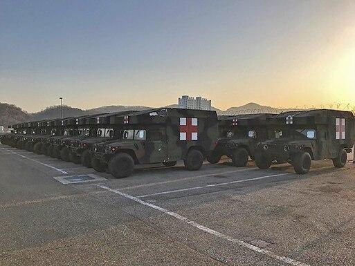 rows of not-yet-demilitarized ambulances