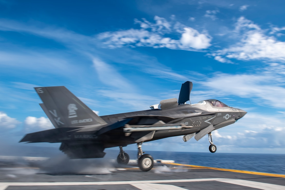 An F-35B Lighting II fighter aircraft from the 31st Marine Expeditionary Unit (MEU) launches off the flight deck of the forward-deployed amphibious assault ship USS America (LHA 6).