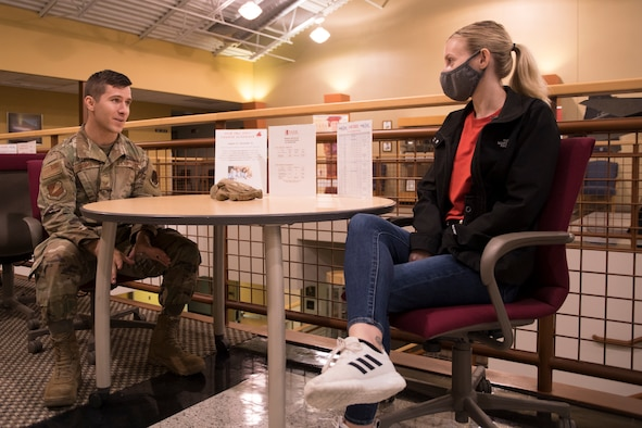 Missouri Air National Guard Staff Sgt. Tyler George, a logistics planner for the 131st Bomb Wing, chats with Eliza Cameron, a 131st Bomb Wing student flight member, July 10, 2021, at Whiteman Air Force Base, Missouri. George is Cameron's sponsor while in student flight. (U.S. Air National Guard photo by Airman 1st Class Whitney Erhart)