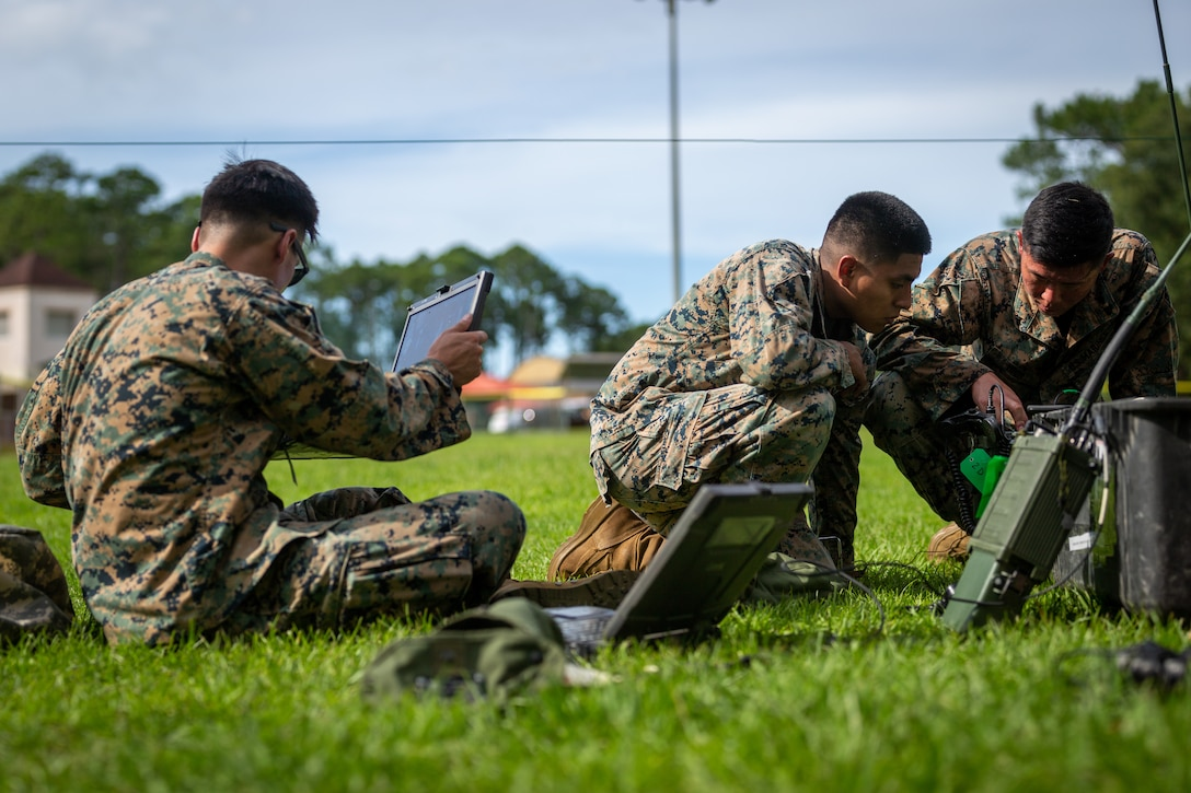 U.S. Marines with 2d Marine Regiment, 2d Marine Division (MARDIV), set up AN/PRC-160(V) radios as part of the 2d MARDIV High-Frequency (HF) Competition on Naval Submarine Base Kings Bay, Ga., July 12, 2021. The competition enhanced HF transmission proficiency and capabilities to prepare Marines for future expeditionary conflicts where the area is either contested or degraded. (U.S. Marine Corps photo by Lance Cpl. Brian Bolin Jr.)