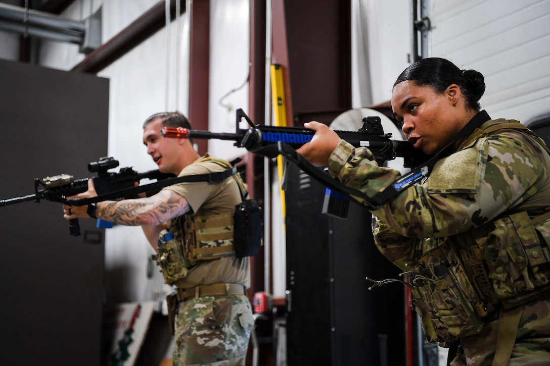Airman 1st Class Hailey Farver, 66th Security Forces Squadron entry controller, and Staff Sgt. Caleb Kenley, partner during a shoot, communicate, and move training at Hanscom Air Force Base, Mass., June 29. The newest issue of body armor was designed specifically to fit females during combat and contingency operations. (U.S. Air Force photo by Lauren Russell)
