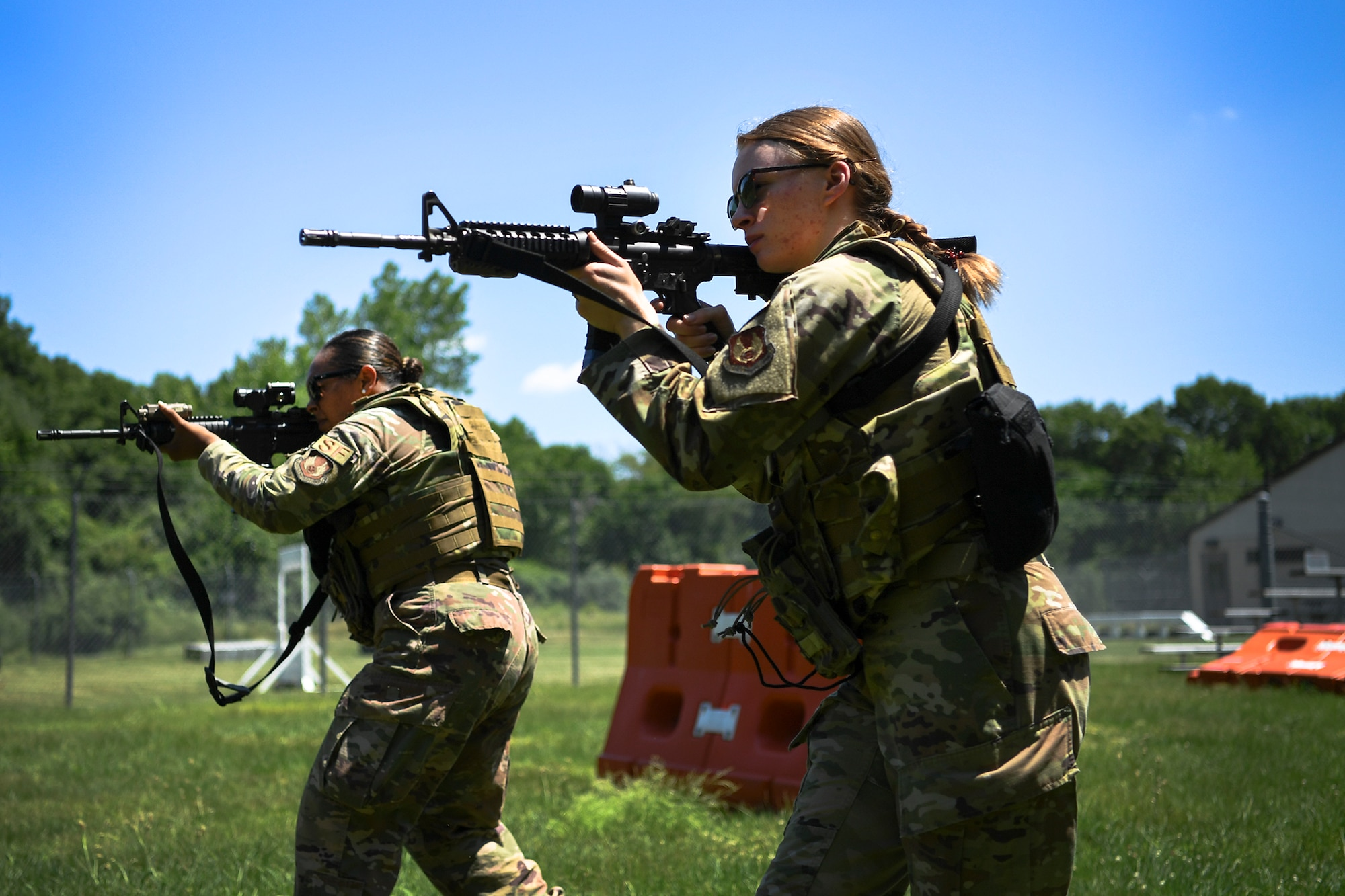 Senior Airman Adrianna Williams, left, and Airman Madalyn Duke, 66th Security Forces Squadron entry controllers, wears female body armor during a shoot, communicate, and move training at Hanscom Air Force Base, Mass., June 29.  The newest issue of body armor was designed specifically to fit females during combat and contingency operations. (U.S. Air Force photo by Lauren Russell)