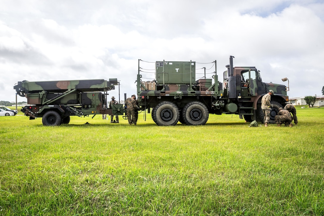 U.S. Marines with 12th Marine Regiment, 3rd Marine Division, set up a Ground and Air Task Oriented Radar system at Marine Corps Air Station Futenma, Okinawa, Japan, Aug. 10, 2020. The G/ATOR allows Marines to see further distances and is used to locate enemy weapon systems. Having this capability further enhances the III Marine Expeditionary mission and increases lethality.