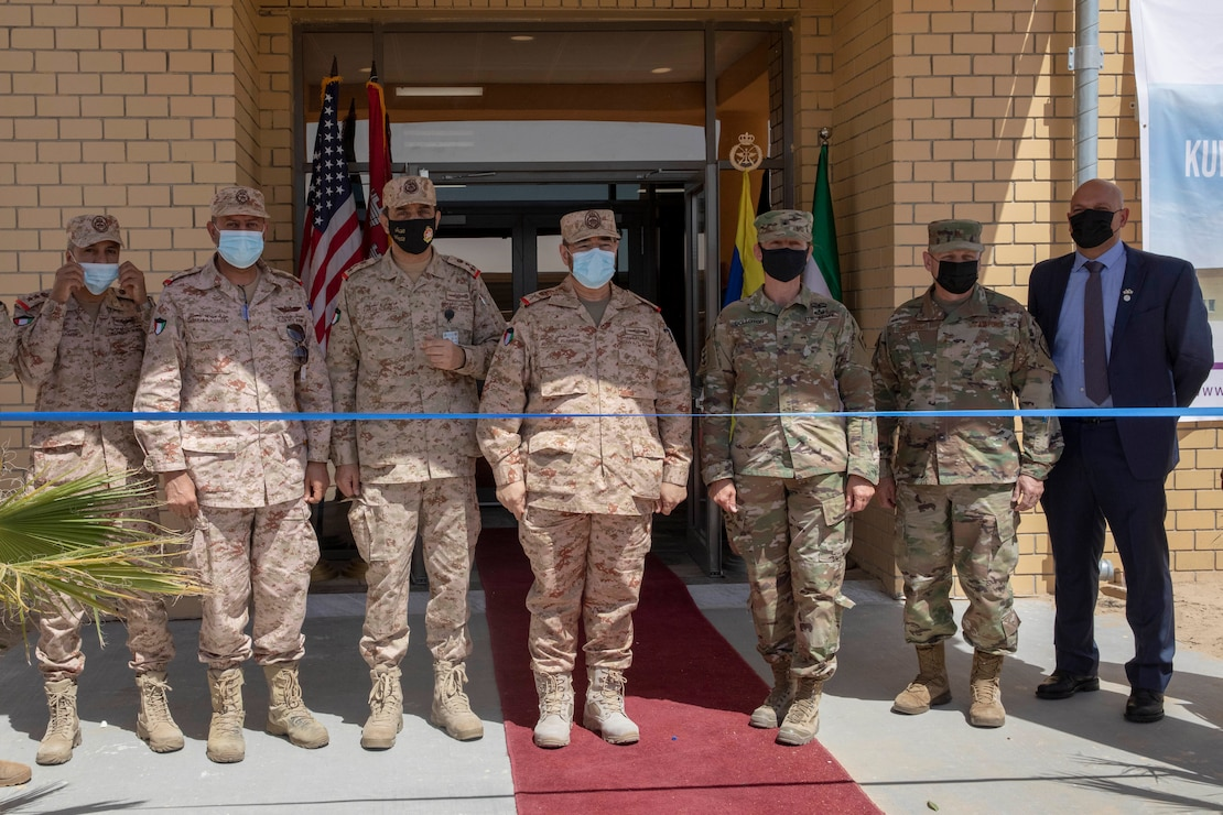 Kuwaiti and American service members and civilians stand together before cutting the ribbon at the new Patriot Fire Site, Site #7, Kuwait, July 5, 2021. Both American and Kuwaiti organizations came together to plan, design, resource, and construct the new Patriot Fire Unit Site, Site #7.