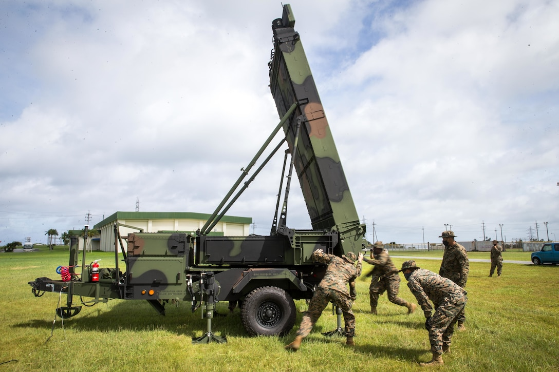 U.S. Marines with 12th Marine Regiment, 3rd Marine Division, adjust a Ground/Air Task Oriented Radar system at Marine Corps Air Station Futenma, Okinawa, Japan, Aug. 10, 2020. The G/ATOR provides an air defense and surveillance capability and is used to locate enemy weapon systems. Having these capabilities further enhances Marines' missions and increases lethality. G/ATOR is one of the Corps' key capabilities supporting Force Design 2030.