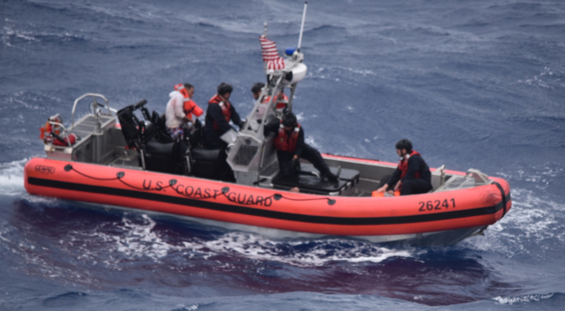 The Coast Guard Cutter Thetis' crewmembers deploy the cutter's small boat to rescue people in the water approximately 32 miles southeast of Key West, Florida, July 7, 2021. The Coast Guard and a good Samaritan rescued 13 people from the water. (U.S. Coast Guard photo by Coast Guard Cutter Thetis crew)