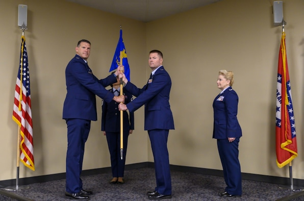 188th Wing Commander Col. Leon Dodroe passes the Mission Support Group guidon to Lt. Col. Dillon Patterson.