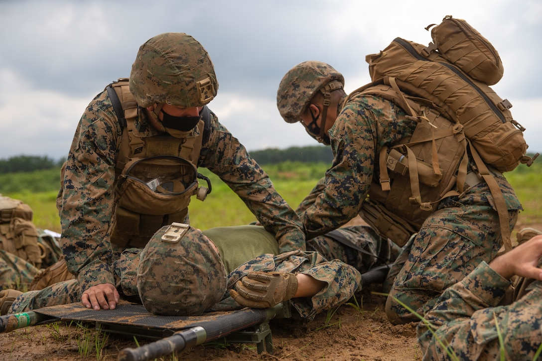 U.S. Marines and Sailors with 3rd Battalion, 12th Marine Regiment, 3rd Marine Division, conduct medical evacuation training during the Artillery Relocation Training Program 21.2 at Ojojihara Maneuver Area, Japan, July 13, 2021. ARTP provides realistic, live-fire training opportunities to the only permanently forward-deployed artillery unit in the Marine Corps, enabling them to provide precision indirect fires from a distributed environment in support of maritime operations. The training contributes to the defense of Japan and the U.S.-Japan Alliance as the cornerstone of peace and security in the Indo-Pacific region.